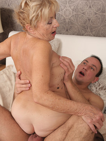 Horny granny Maya Lambert gets a pussy lick & rides on top of her young lover