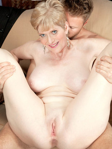 Horny mature lady Sindee Dix takes a young man's dick in her mouth & pussy