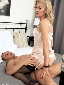 Hot granny Beata has sex with toy boy in sensual lingerie and stockings