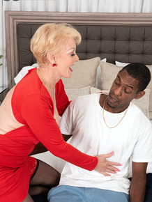 Blonde granny Seka Black seduces a man with a big black dick in his pants