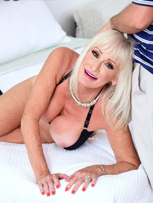 Hot granny Leah L'Amour sucks off a young man while her husband snoozes