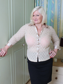Plump UK granny undresses her young lover-boy for a hard fuck session