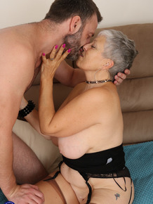 Old lady with grey hair is stripped naked by a much younger man