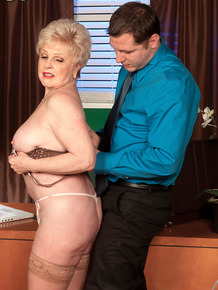Older businesswoman Jewel seduces a younger coworker in tan stockings