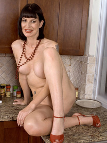 Older lady Audrey Maxx climbs onto kitchen counter to pleasure herself in sink