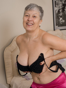 Grey haired gran from the UK strips to her silk underwear and nylons
