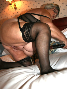 Nerdy Grandma Libby inserting a huge black dildo inside her fat pussy