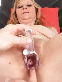 Older blonde lady in stockings Susan undergoing gyno doc's fetish kinks