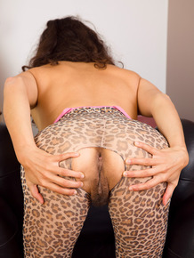 Pretty MILF Isabelle in crotchless pantyhose spreading her hairy beaver lips