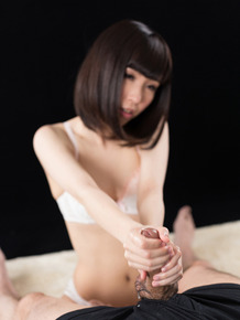 Hot Japanese female flashes her pussy before jerking a cock to ejaculation