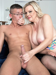 Wild mom Lena Lewis seducing a young man to get a taste of his hard big cock