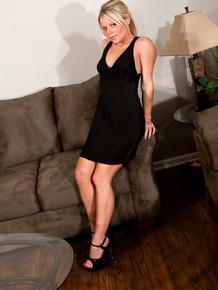 Clothed MILF Meet Madden is all tease while taking off her dress