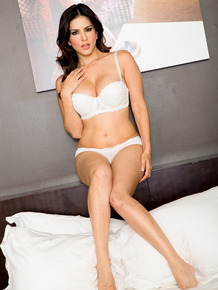 Glamorous Sunny Leone performs a steamy striptease spreading perfect legs