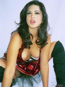 Black-haired Indian in latex blood-red dress Sunny Leone bares sexy tits