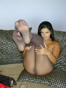 Brunette solo model Sunny Leone goes topless in black pantyhose