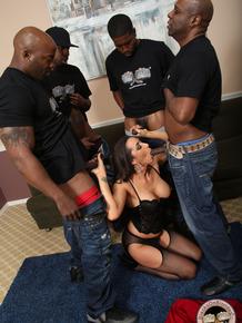 Brunette skank Kaylynn takes on a a bevy of big black cocks in messy blowbang