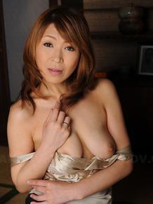 Lovely Japanese MILF Jun Kusanagi gets her soaking wet pussy fingered