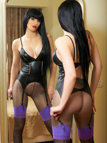 Black haired Nylon Queen posing in black stockings & latex flaunting sexy feet