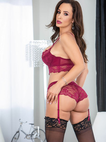 Businesswoman Lisa Ann strips to bra and panty set in stockings
