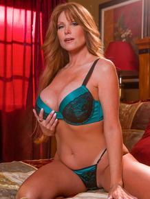 Sexy redhead MILF pornstar Darla Crane doffs her bra to tease with big tits