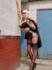 Busty MILF Michelle Thorne looses trench coat to spread naked muff in an alley