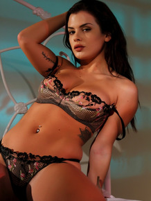 Busty babe Keisha Grey slowly takes off her hot lingerie and poses late night