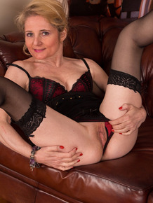 Older lady with blond hair Lily Roma takes off little black dress in stockings