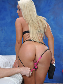 Sexy young blonde masseuse oils up her hot ass to ride client's hard cock