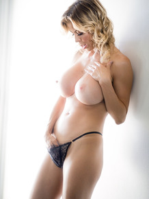 Dirty blonde female Alexis Fawx shows her bare ass after undressing