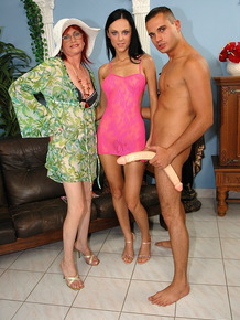 Redhead granny gets fucked by a younger guy and girl and a giant dildo