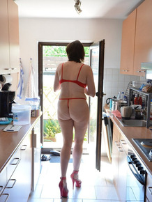 Leggy woman does her housework in bra and thong with matching heels