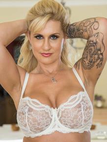 Inked MILF Ryan Conner enjoys posing in her sexy white lingerie