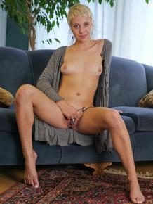 Blonde amateur Lily Lennox closes here eyes while masturbating
