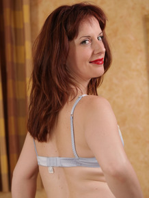 Older lady Dirty Angie slips off her retro underwear in tan nylons