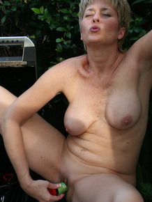 Mature female Tracy Lick heats up a sex toy on the BBQ before masturbating