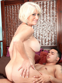 Hot 50 plus lady Desire Collins rides on top of her younger Latino lover