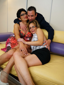 Mature housewives in glasses go splits on a male escort for a threesome