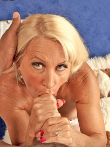 Mature blonde woman blows a black man's dick after seducing him