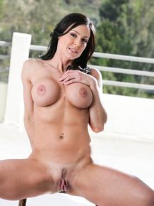 Brunette female Kendra Lust removes yoga attire while seducing her man