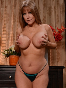 Busty housewife Darla Crane stripping and masturbating late hours