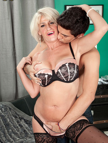 Hot mature woman Desire Collins gets fucked after seducing a younger boy