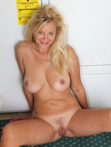 Busty blonde mature Heidi Gallo spreading ass naked in the laundry room