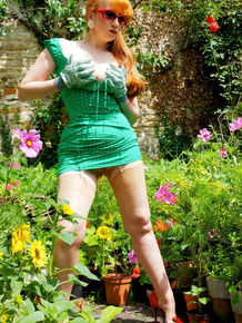 Busty chick Red XXX shows the pink of her pussy out in the garden