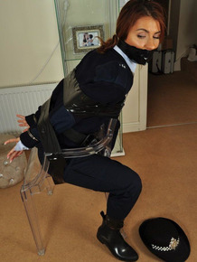 Female Bobbie finds herself ties up and gagged on an investigation