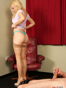 Leggy blonde chick Penny Lee takes off her dress while watching a man jack off