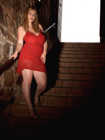 Strawberry blonde BBW Terry Nova models non nude in a red dress