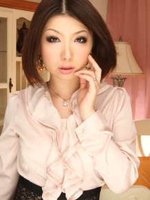Delicious Asian babe Tsubaki poses in her lovely uniform before going to work