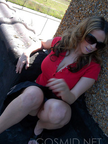 Non nude amateur Lisa Davidson takes off sunglasses in a short skirt outdoors