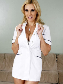 Blonde massage therapist Tanya Tate undresses for nude poses on massage table