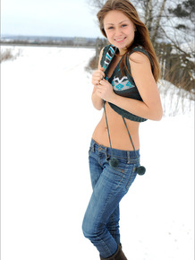 Cutie in jeans and boots undresses to run around naked in the snow